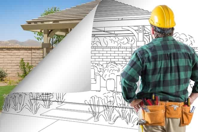 worker from Rockhampton Carports looking at a blueprint project
